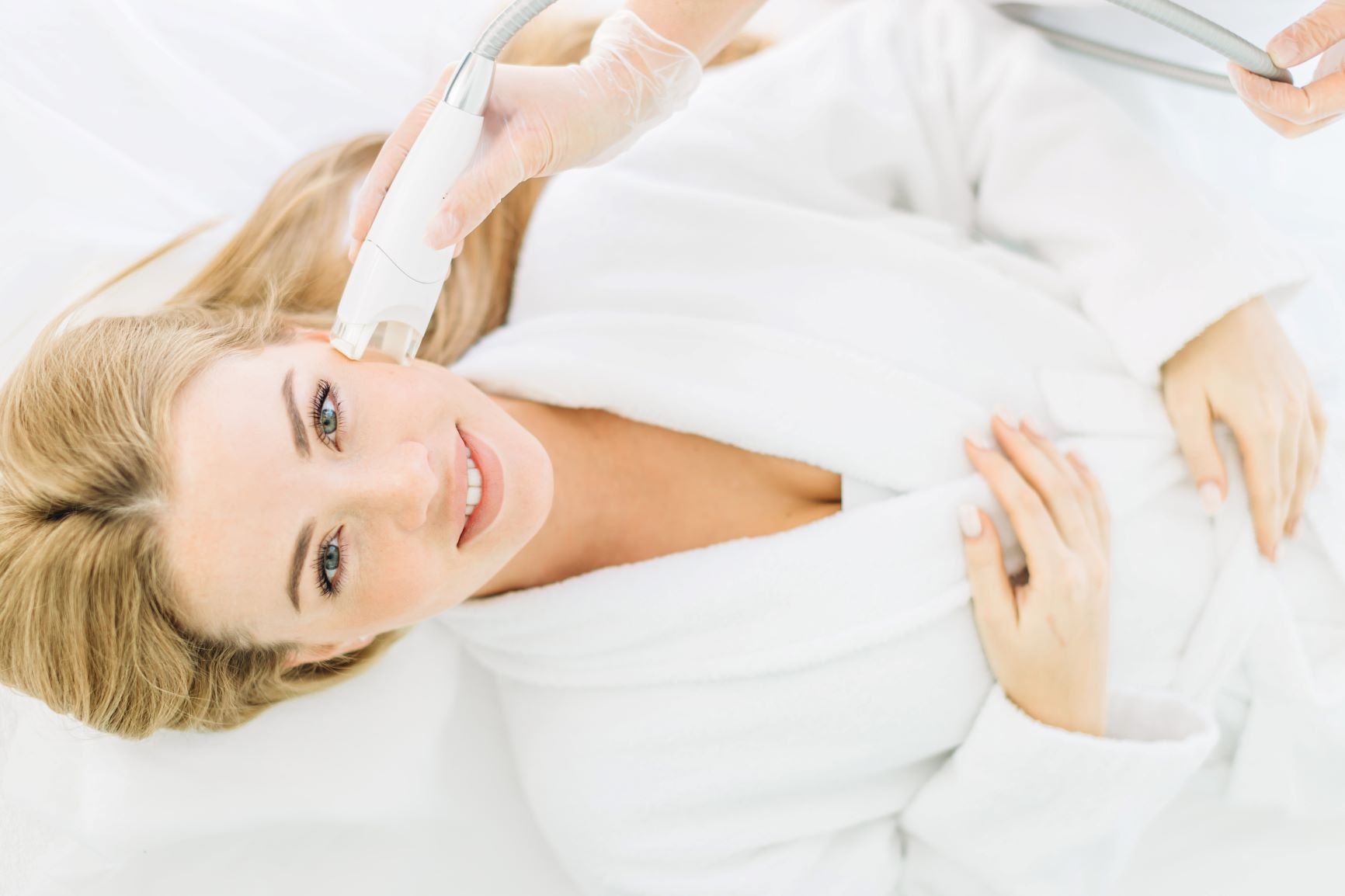 blonde woman receiving laser hair removal treatement